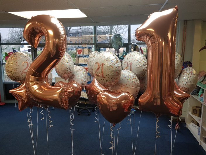 21st Birthday Balloons Centrepieces at Coalville Rugby Club from Party Save Smile. Specialists in Party Supplies for childrens, age milestones and more.