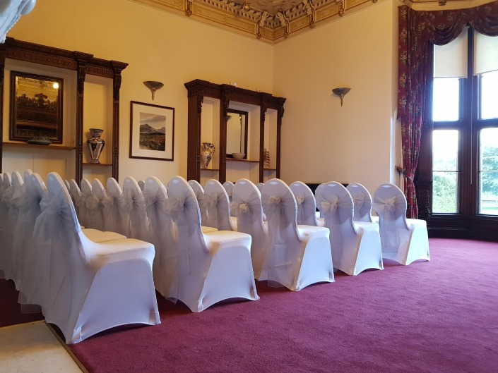 White Wedding Chair Cover and Silver Sash Hire including delivery, setup and collection at Beaumanor Hall in Woodhouse Eaves, Leicestershire by the Party Save Smile events team.